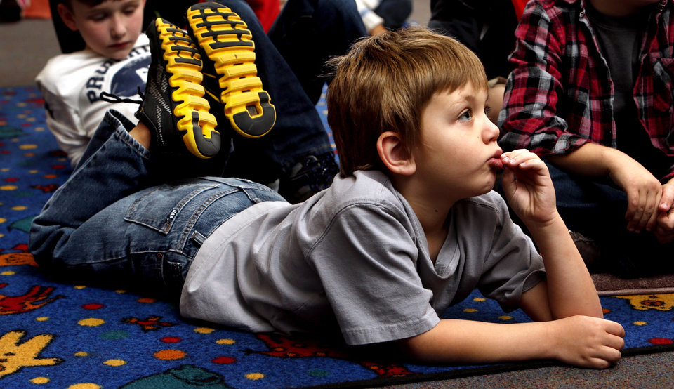 Kolton Southerland, 6, listens to a story at the after-school special story time at  Norman Public Library. PHOTO BY STEVE SISNEY, THE OKLAHOMAN <strong>STEVE SISNEY</strong>