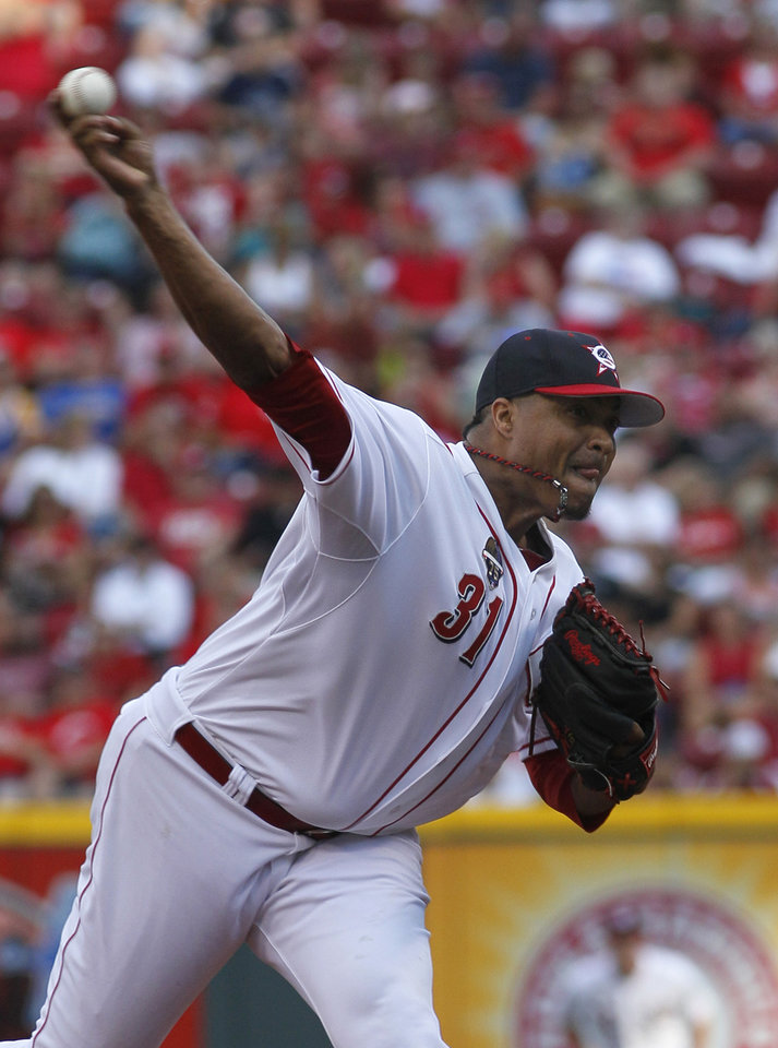 Photo - Cincinnati Reds' Alfredo Simon pitches against the Milwaukee Brewers in the first inning of their baseball game in Cincinnati, Friday July 4, 2014. (AP Photo/Tom Uhlman)