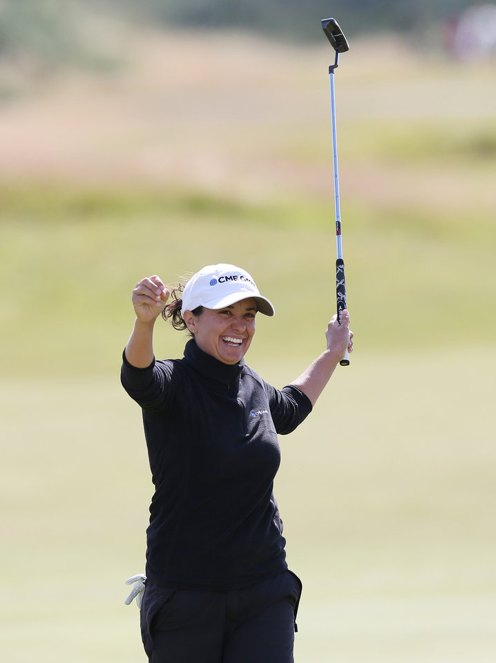 Photo - Mo Martin of the U.S celebrates after finishing her round on the 18th green the Women's British Open golf championship at the Royal Birkdale Golf Club, in Southport, England, Sunday, July 13, 2014. (AP Photo/Scott Heppell)