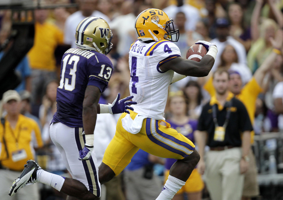 Photo -   LSU running back Alfred Blue (4) rushes past Washington safety Will Shamburger (13) for a touchdown during the first half of an NCAA college football game in Baton Rouge, La., Saturday, Sept. 8, 2012. (AP Photo/Gerald Herbert)