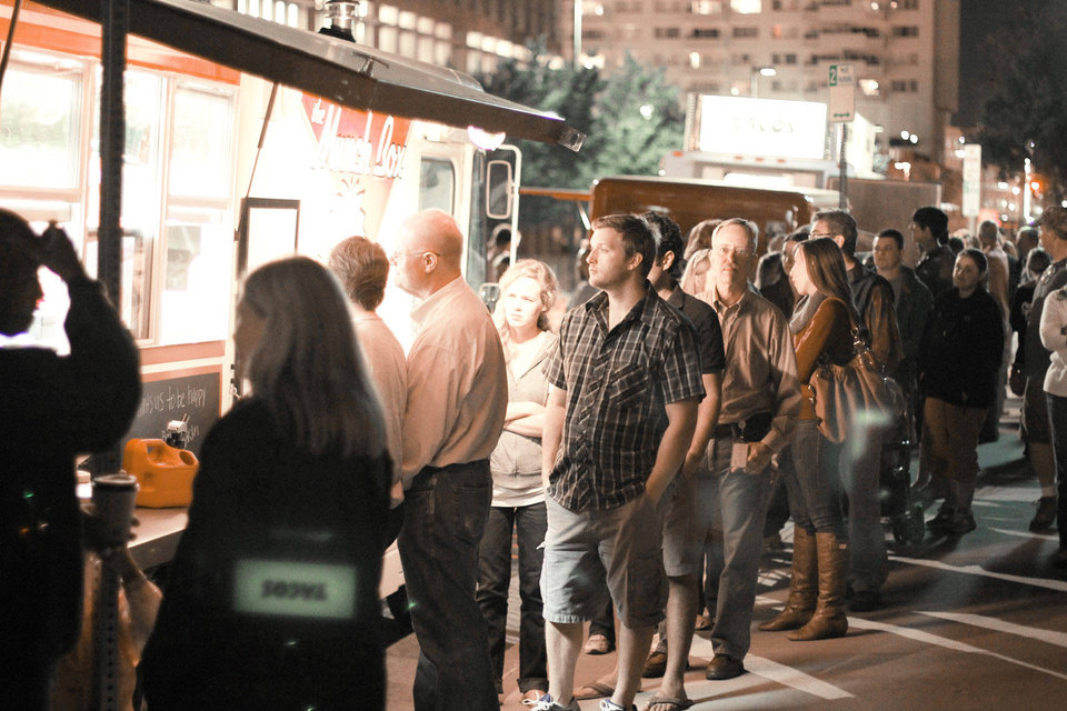 People gather near Hudson Avenue and NW 8 for H & 8th in this 2011 file photo. The H & 8th Night Market returned in March.  Photo by Doug Hoke, The Oklahoman Archives