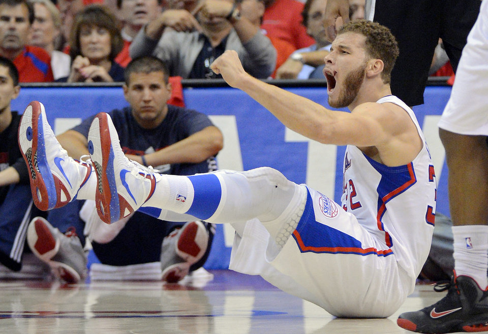 Photo -   Los Angeles Clippers forward Blake Griffin reacts to a foul call during the first half in Game 4 of an NBA basketball playoffs Western Conference semifinal against the San Antonio Spurs, Sunday, May 20, 2012, in Los Angeles. (AP Photo/Mark J. Terrill)