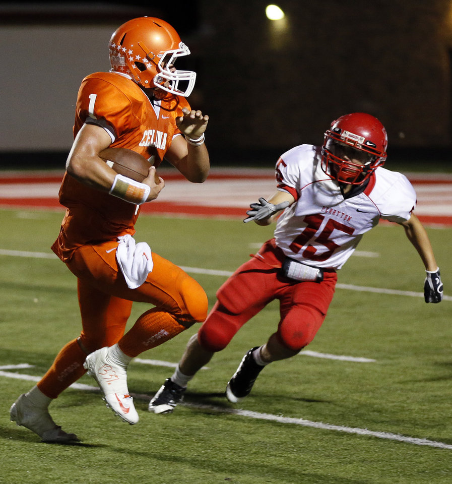 Photo - Celina quarterback Nathan Elliott (11) gets past Perryton's Garrett Good (15) on his way to a touchdown during a high school football game between Texas's Celina Bobcats and Perryton Rangers in the old football stadium at Yukon Middle School in Yukon, Okla., Friday, Sept. 28, 2012. Photo by Nate Billings, The Oklahoman