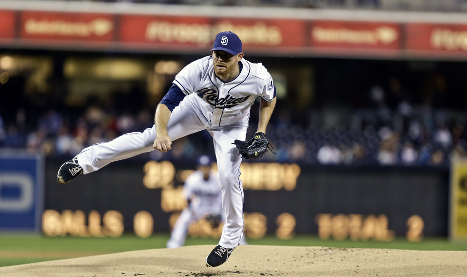 Photo - San Diego Padres starting pitcher Ian Kennedy sails off the ground while throwing a pitch against the Arizona Diamondbacks in the first inning of a baseball game Wednesday, Sept. 25, 2013, in San Diego. (AP Photo/Lenny Ignelzi)