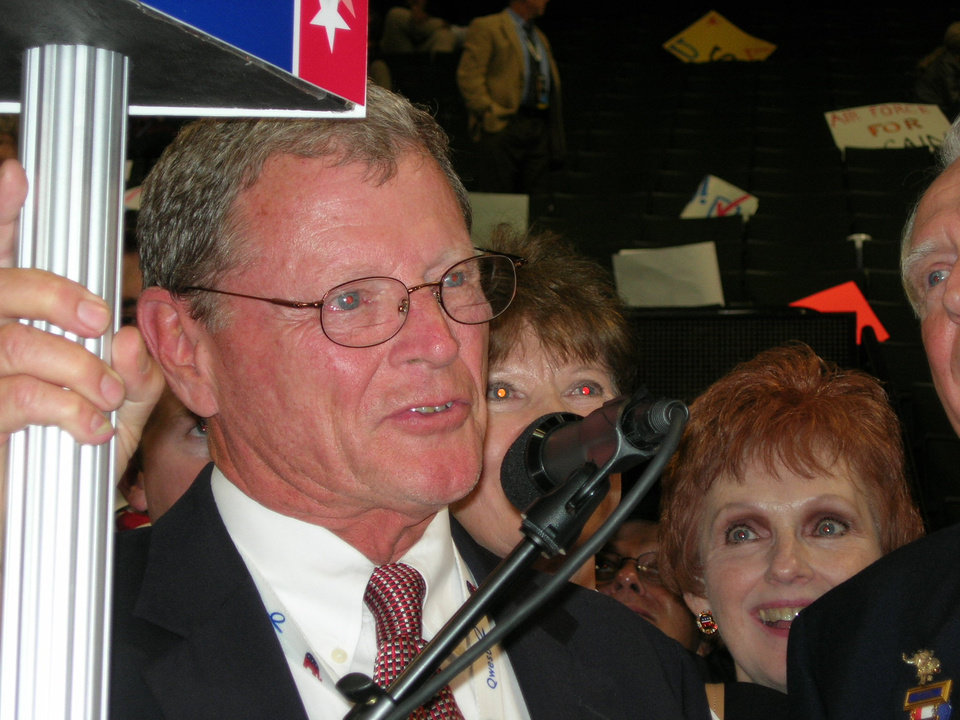 Photo - U.S. Sen. Jim Inhofe, R-Tulsa, prepares Wednesday to announce the  Oklahoma delegation's presidential vote during the Republican National Convention in St. Paul, Minn., only to have his microphone turned off before announcing two votes for Ron Paul.  PHOTO BY MICHAEL MCNUTT/THE OKLAHOMAN    ORG XMIT: 0809042213214141