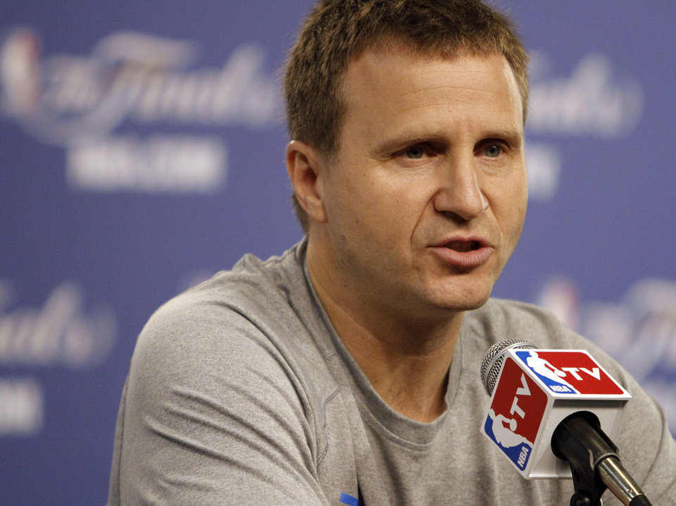 Photo - Thunder coach Scott Brooks talks to the media during the NBA Finals practice day at the Chesapeake Energy Arena on Monday, June 11, 2012, in Oklahoma City, Okla. Photo by Chris Landsberger, The Oklahoman