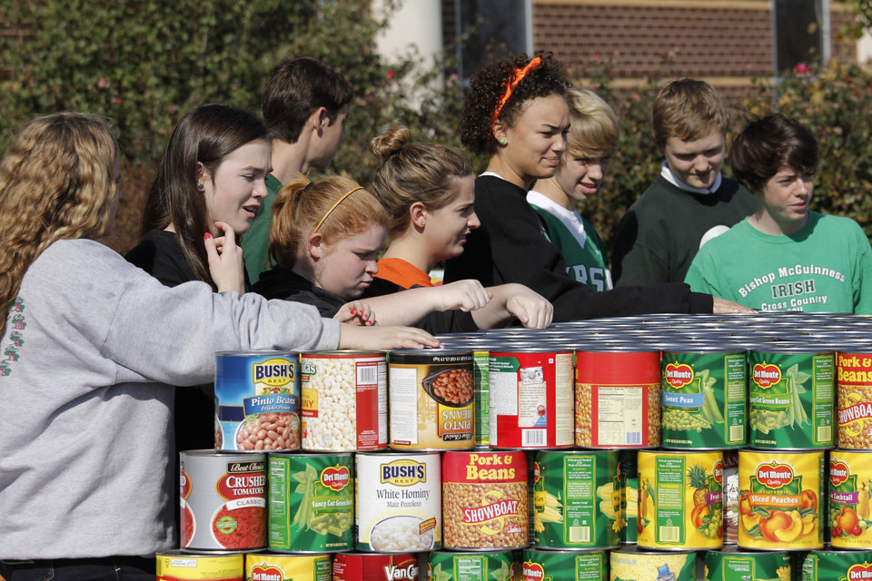 Students wait to load food collected for the Regional Food Bank of Oklahoma at Bishop McGuinness High School Friday, November 9, 2012.  The school collected 75,660 pounds of food. Photo by Doug Hoke, The Oklahoman