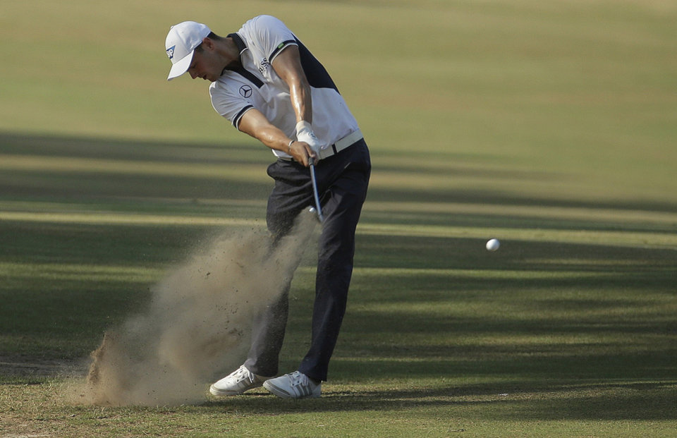 Photo - Martin Kaymer, of Germany, hits from the natural area on the 10th hole during the final round of the U.S. Open golf tournament in Pinehurst, N.C., Sunday, June 15, 2014. (AP Photo/Charlie Riedel)