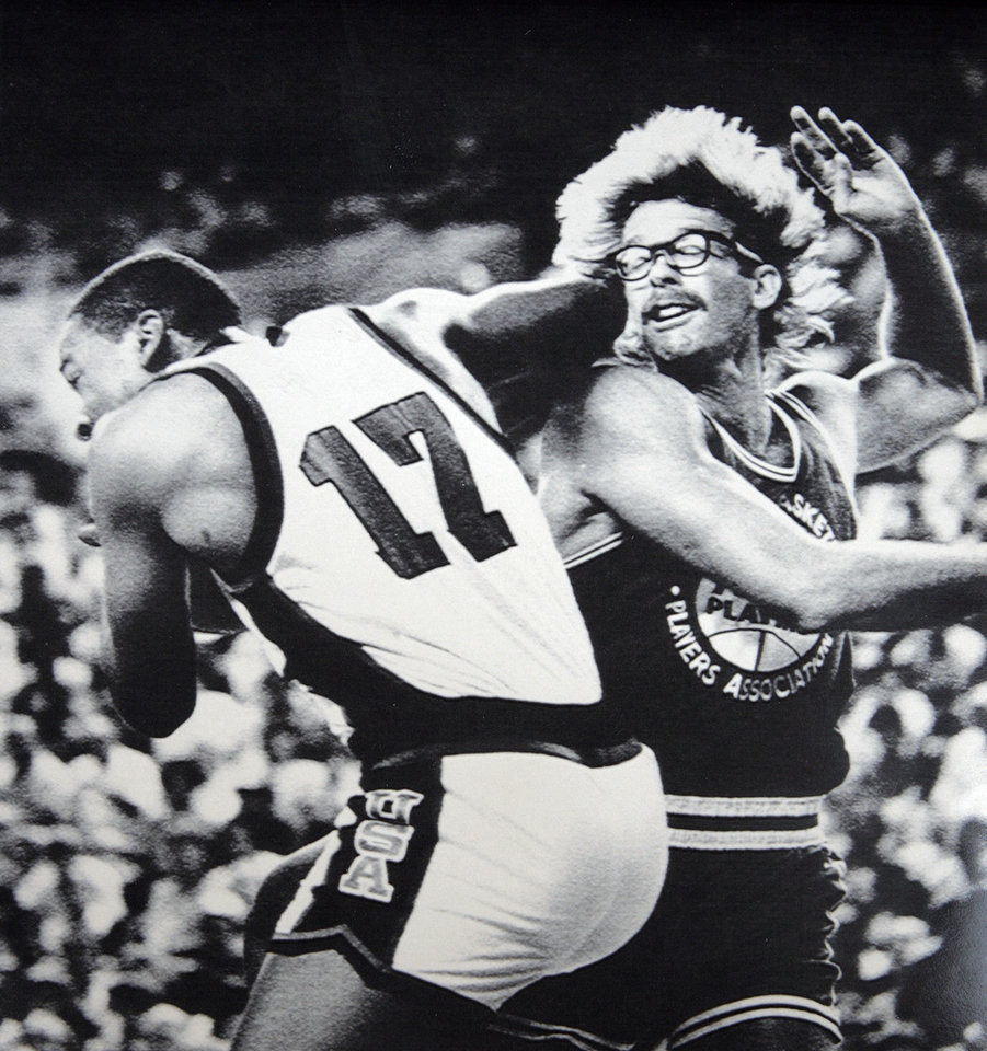 Photo - Former OU basketball player Wayman Tisdale. Phoenix, Arizona, July 21- REBOUND -- USA Olympic Team forward Wayman Tisdale (17) grabs a rebound over NBA All-Star forward Kurt Rambis during first half basketball action in Phoenix Saturday afteroon. (AP LaserPhoto) Photo by M. Spector 1984. Photo taken 7-21-1984, Photo published 7-22-1984 in The Daily Oklahoman. ORG XMIT: KOD