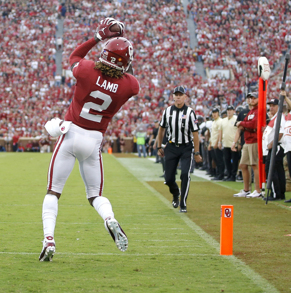 Photo - Oklahoma's CeeDee Lamb (2) catches a touchdown pass during a college football game between the University of Oklahoma Sooners (OU) and the Army Black Knights at Gaylord Family-Oklahoma Memorial Stadium in Norman, Okla., Saturday, Sept. 22, 2018. Photo by Bryan Terry, The Oklahoman