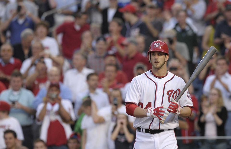 Washington Nationals' Bryce Harper heads to the plate as the fans stands up during the first inning of a baseball game between the Nationals and the Arizona Diamondbacks at Nationals Park in Washington, Tuesday, May 1, 2012. (AP Photo/Susan Walsh)