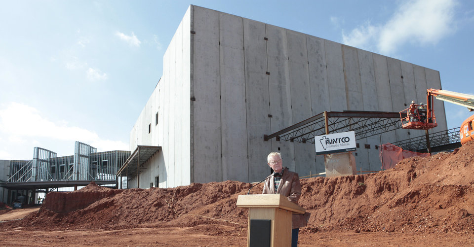 Photo - School Board President David Miller speaks Tuesday at Deer Creek Public Schools' topping-out ceremony for the Deer Creek Performing Arts and Athletic Center.