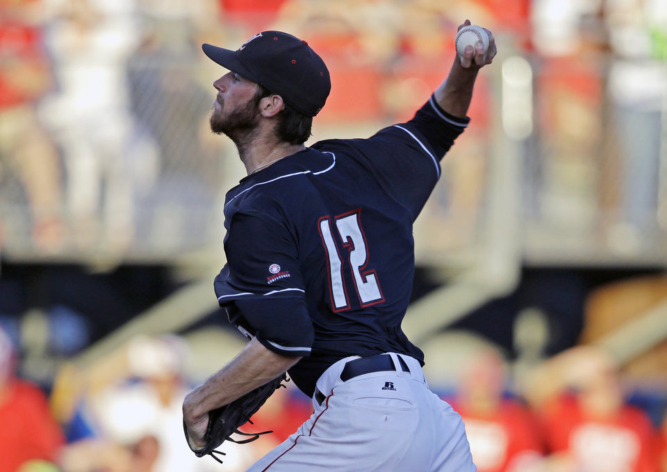 Photo - Louisiana Lafayette pitcher Austin Robichaux (12) pitches in the second inning of an NCAA college baseball tournament super regional game against Mississippi in Lafayette, La., Saturday, June 7, 2014. (AP Photo/Gerald Herbert)