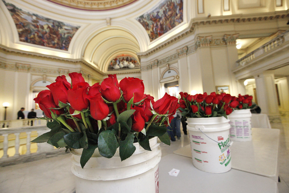 Photo - Buckets of roses to be distributed to  legislators are gathered in the rotunda of the state Capitol during the 2013 Rose Day sanctity of life activities. Photo by Paul B. Southerland, The Oklahoman Archives  PAUL B. SOUTHERLAND - PAUL B. SOUTHERLAND
