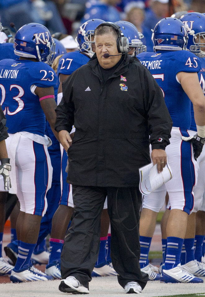 Photo -   FILE - In this Oct. 13, 2012, file photo, Kansas coach Charlie Weis walks the sideline during the first half of an NCAA college football game against Oklahoma State in Lawrence, Kan. Weis is off to a 1-6 start at Kansas, and his hope for instant success behind fifth-year transfers has been scuttled. (AP Photo/Orlin Wagner, File)