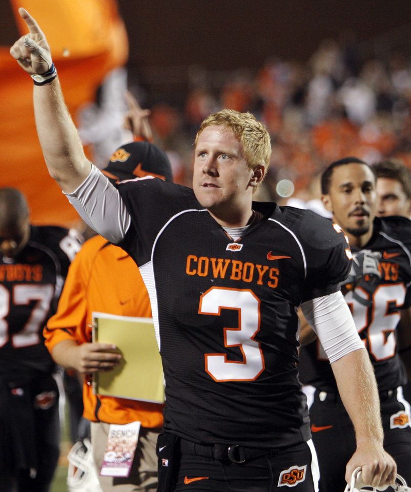 Photo - OSU quarterback Brandon Weeden (3) points into the stands after the college football game between Texas A&M University and Oklahoma State University (OSU) at Boone Pickens Stadium in Stillwater, Okla., Thursday, Sept. 30, 2010. OSU won, 38-35. Photo by Nate Billings, The Oklahoman
