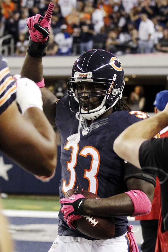 Photo -   Chicago Bears cornerback Charles Tillman celebrates after returning an interception for a touchdown during the first half of an NFL football game against the Dallas Cowboys, Monday, Oct. 1, 2012, in Arlington, Texas. (AP Photo/Tony Gutierrez)