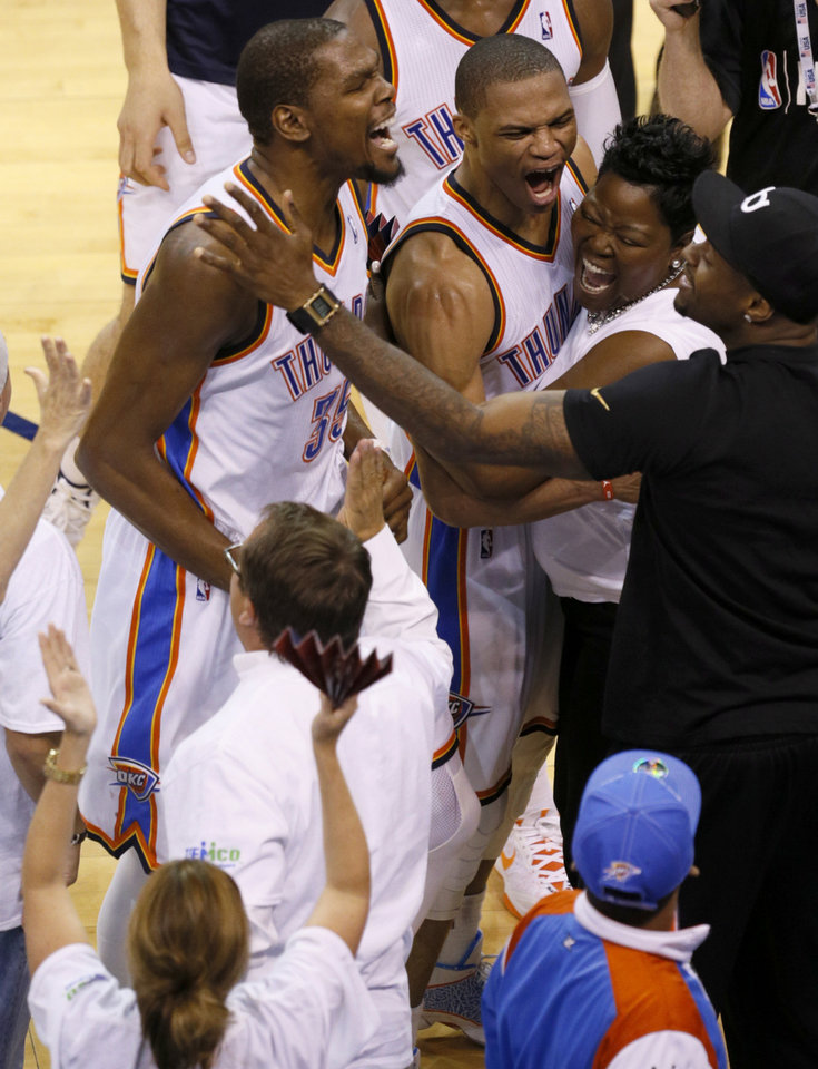 Oklahoma City's Russell Westbrook (0) and Kevin Durant (35) celebrate with Durant's mother  Wanda Pratt during Game 5 of the Western Conference semifinals in the NBA playoffs between the Oklahoma City Thunder and the Los Angeles Clippers at Chesapeake Energy Arena in Oklahoma City, Tuesday, May 13, 2014. Photo by Bryan Terry, The Oklahoman