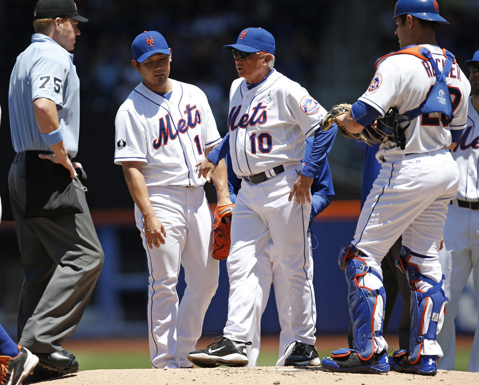 Photo - New York Mets manager Terry Collins (10) points to Mets starting pitcher Daisuke Matsuzaka as he talks to home plate umpire Tom Woodring (75) after being called to the mound during a baseball game against the San Diego Padres in New York, Sunday, June 15, 2014. (AP Photo/Kathy Willens)