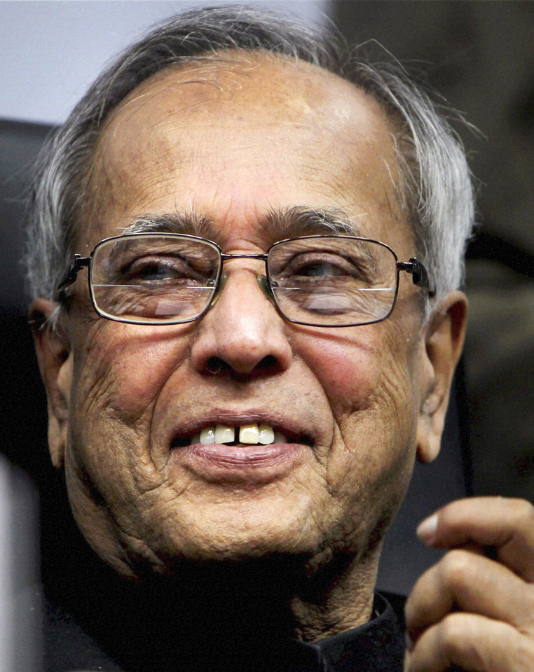 Photo -   FILE- In this March 24, 2012 file photo, Indian Finance Minister Pranab Mukherjee, gestures during a function in New Delhi, India. Mukherjee, is heading for a victory in the election for India's next president, a largely ceremonial role.(AP Photo, file)