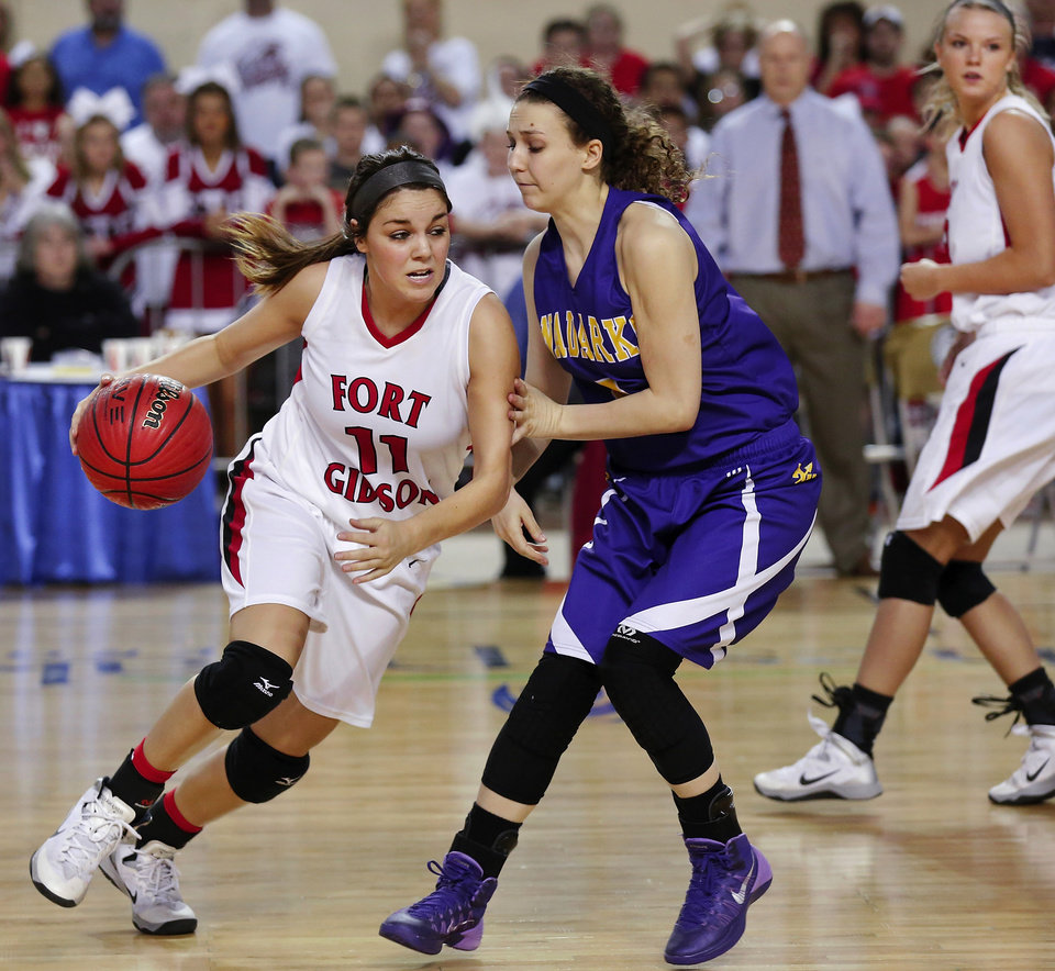 Photo - Ft, Gibson's Savannah Gray works to get around Anadarko defender Kelsey Schumpert during the Class 4A State championship game between Ft. Gibson and Anadarko at Jim Norick Arena at State Fair Park  on Saturday, Mar. 15, 2014. Ft. Gibson came from behind much of the second half to win 50-47.  Photo by Jim Beckel, The Oklahoman