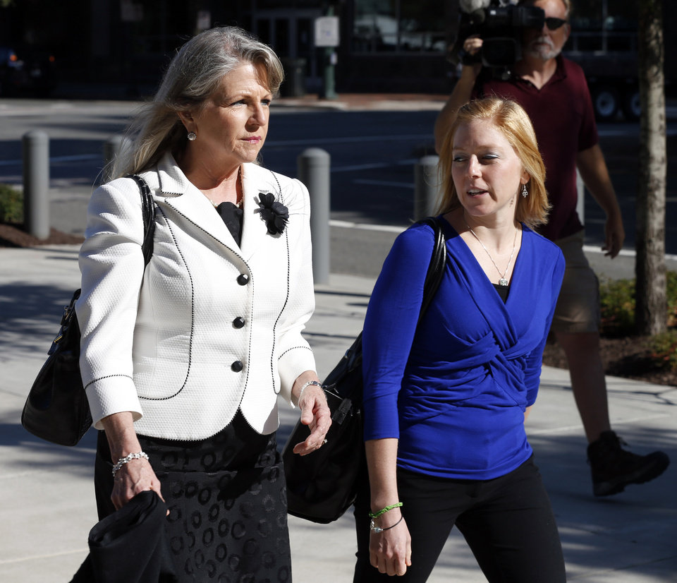 Photo - Former Virginia first lady Maureen McDonnell, left, and her daughter Cailin Young arrive at federal court, Wednesday, Aug. 27, 2014, in Richmond, Va.  The defense in her corruption case is expected to rest today. McDonnell and his husband Bob, the former Virginia Governor, are charged with accepting more than $165,000 in gifts and loans from former Star Scientific Inc. CEO Jonnie Williams in exchange for promoting his company's dietary supplements.  (AP Photo/Steve Helber)