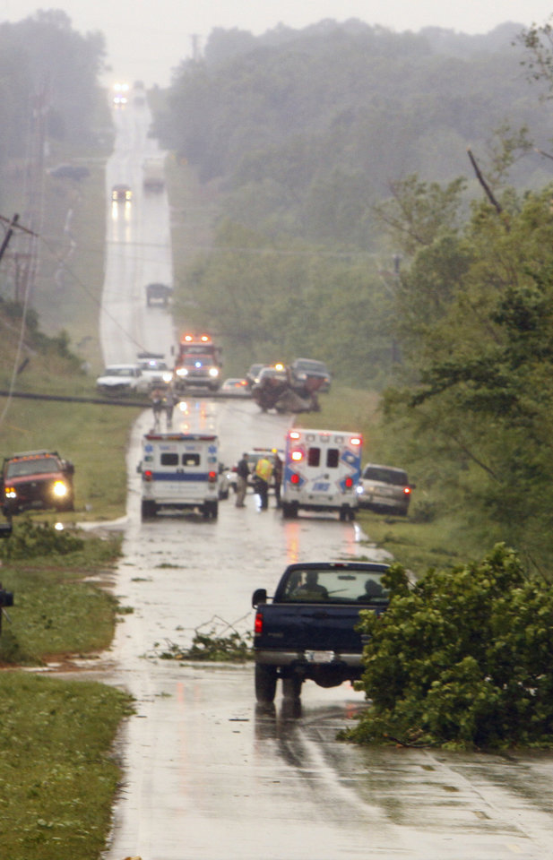 Emergency personnel arrive on 180th street north of Highway 9 near Little Axe after a storm tore through the area on Monday, May 10, 2010, in Norman, Okla.  Photo by Steve Sisney, The Oklahoman