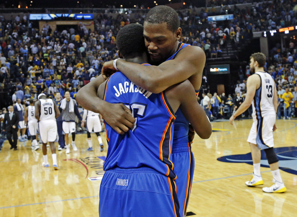 Oklahoma City's Reggie Jackson (15) celebrates with Kevin Durant (35) after Game 4 in the first round of the NBA playoffs between the Oklahoma City Thunder and the Memphis Grizzlies at FedExForum in Memphis, Tenn., Saturday, April 26, 2014. Photo by Bryan Terry, The Oklahoman