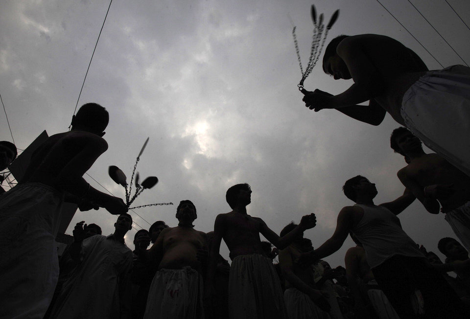 Pakistani Shiite Muslims flagellate themselves during a Muharram procession in Peshawar, Pakistan on Saturday, Nov. 24, 2012. Muharram is a month of mourning in remembrance of the martyrdom of Imam Hussein, the grandson of Prophet Mohammed. (AP Photo/Mohammad Sajjad)