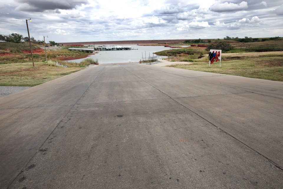 Photo - Boat ramp at Foss Lake where two cars were pulled from the lake this week.  David McDaniel - The Oklahoman