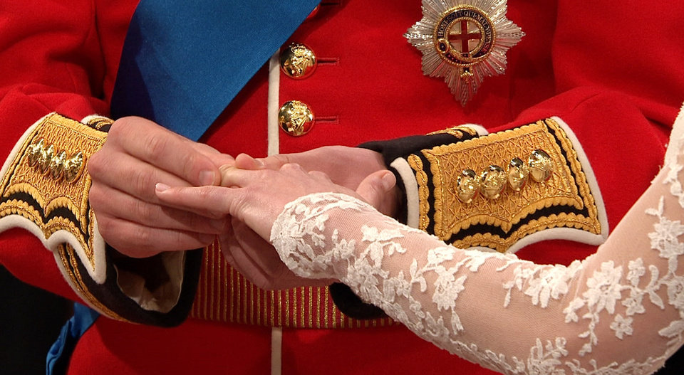 Photo - In this image taken from video, Britain's Prince William, left, places the ring on the finger of his bride, Kate Middleton, as they stand at the altar at Westminster Abbey for the Royal Wedding in London on Friday, April, 29, 2011. (AP Photo/APTN) EDITORIAL USE ONLY NO ARCHIVE PHOTO TO BE USED SOLELY TO ILLUSTRATE NEWS REPORTING OR COMMENTARY ON THE FACTS OR EVENTS DEPICTED IN THIS IMAGE ORG XMIT: RWVM168