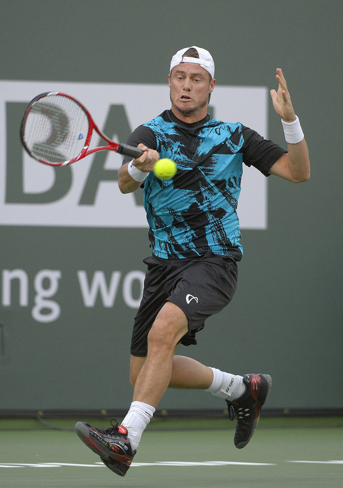 Photo - Lleyton Hewitt, of Australia, returns a shot against Matthew Ebden, also of Australia, during a first-round match at the BNP Paribas Open tennis tournament on Thursday, March 6, 2014, in Indian Wells, Calif. (AP Photo/Mark J. Terrill)