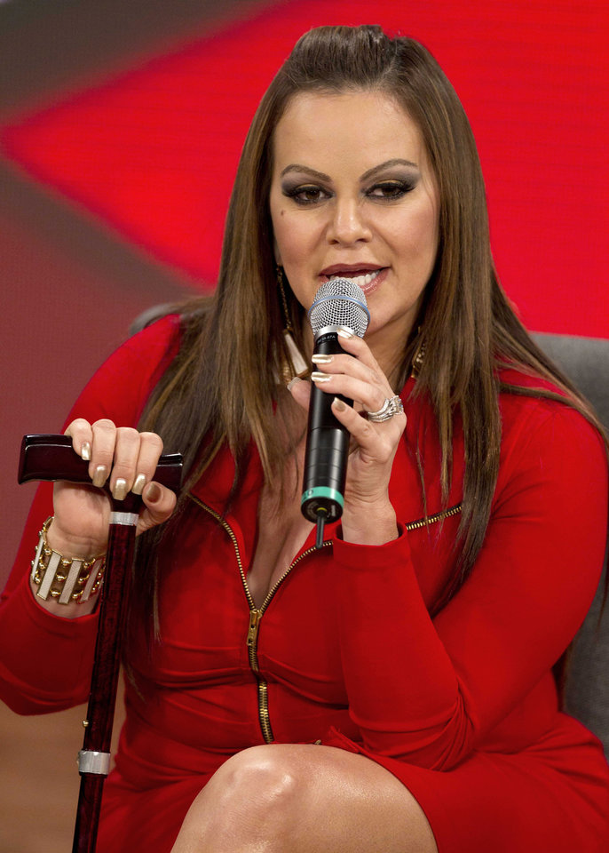 "FILE - In this Aug. 21, 2012, file photo, singer and singing coach Jenni Rivera speaks during a press conference promoting the second season of reality show, ""La Voz Mexico"" in Mexico City. The wreckage of a small plane believed to be carrying Mexican-American music superstar Jenni Rivera was found in northern Mexico on Sunday, Dec. 9, 2012, and there are no apparent survivors, authorities said.  (AP Photo/Eduardo Verdugo, file)"