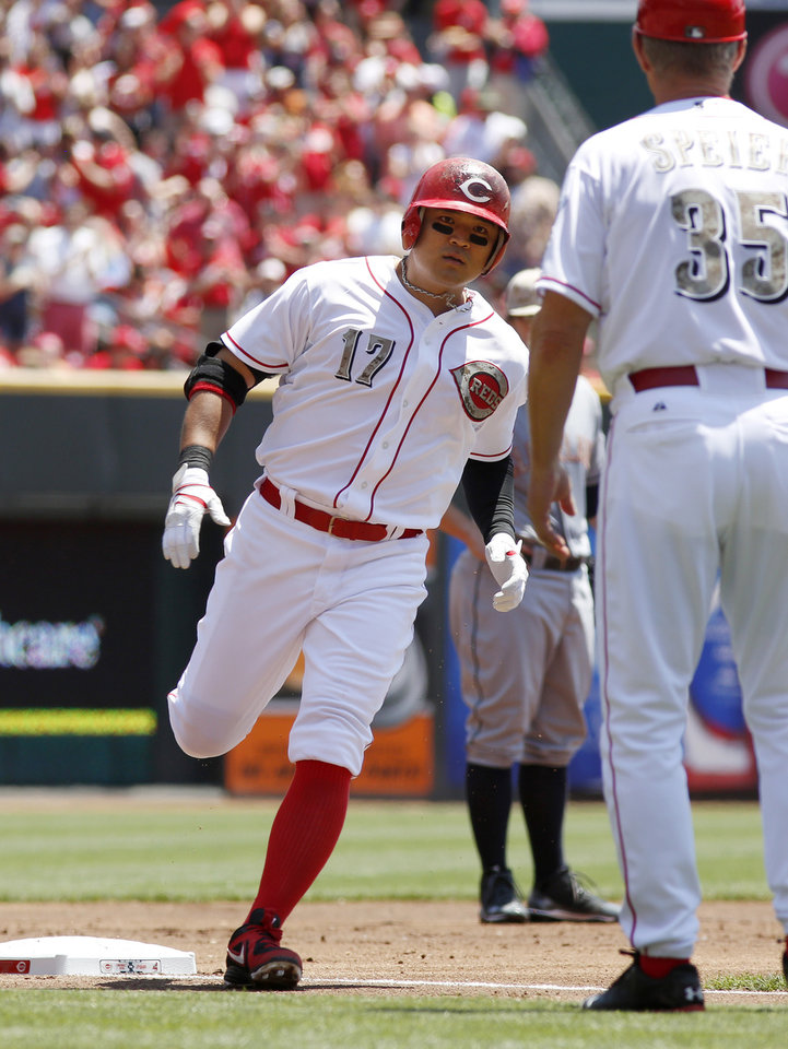 Photo - Cincinnati Reds center fielder Shin-Soo Choo, left, is congratulated by third base coach Chris Speier, right, in the first inning during a baseball game, Monday, May 27, 2013, in Cincinnati. (AP Photo/David Kohl)