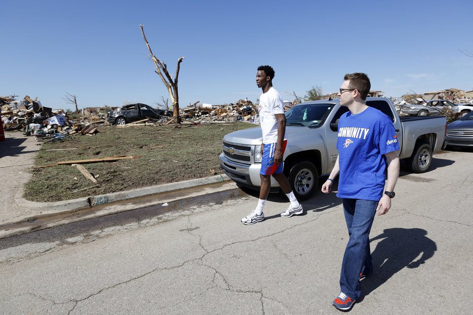 Oklahoma City Thunder\'s Hasheem Thabeet and General Manager Sam Presti survey damage near SW 144th and Robinson in Oklahoma City, Wednesday May 22, 2013. Members of the Oklahoma City Thunder and family members took a tour of the area hit by a tornado on Monday afternoon. Photo By Steve Gooch, The Oklahoman