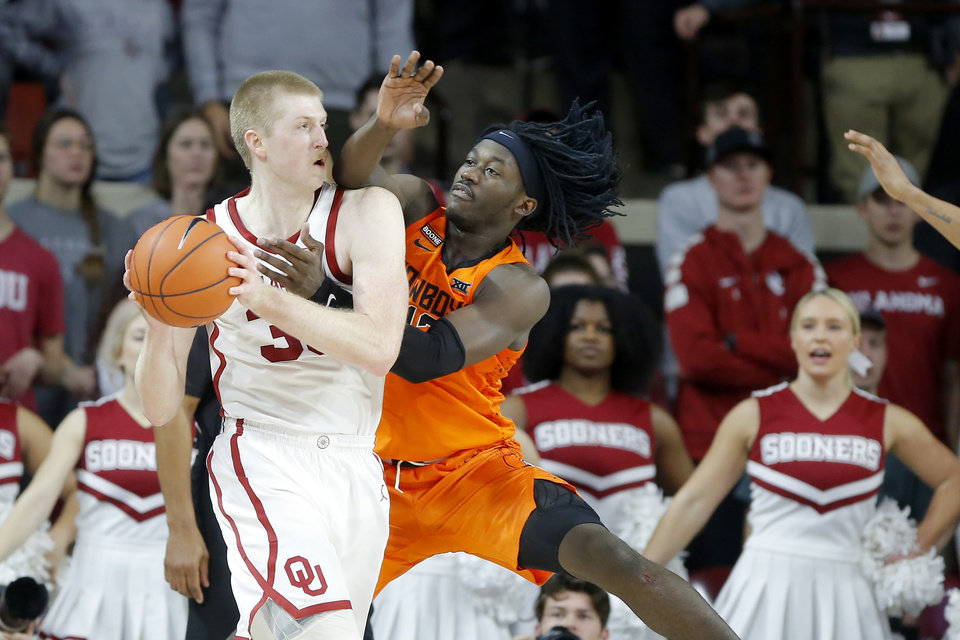 Photo - Oklahoma State's Isaac Likekele (13) defends Oklahoma's Brady Manek (35) during a Bedlam college basketball game between the University Oklahoma Sooners (OU) and the Oklahoma State Cowboys (OSU) at the Lloyd Noble Center in Norman, Okla., Saturday, Feb. 1, 2020. Oklahoma won 82-69. [Bryan Terry/The Oklahoman]