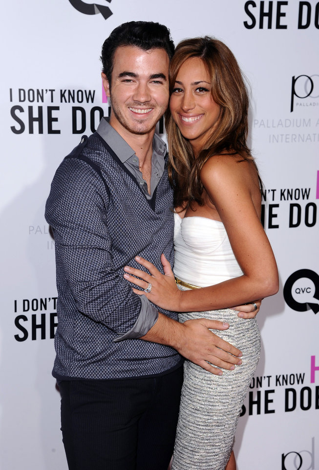 Photo -   FILE - This Sept. 12, 2011 file photo shows Singer Kevin Jonas, left, and his wife Danielle Deleasa attend the Cinema Society premiere of