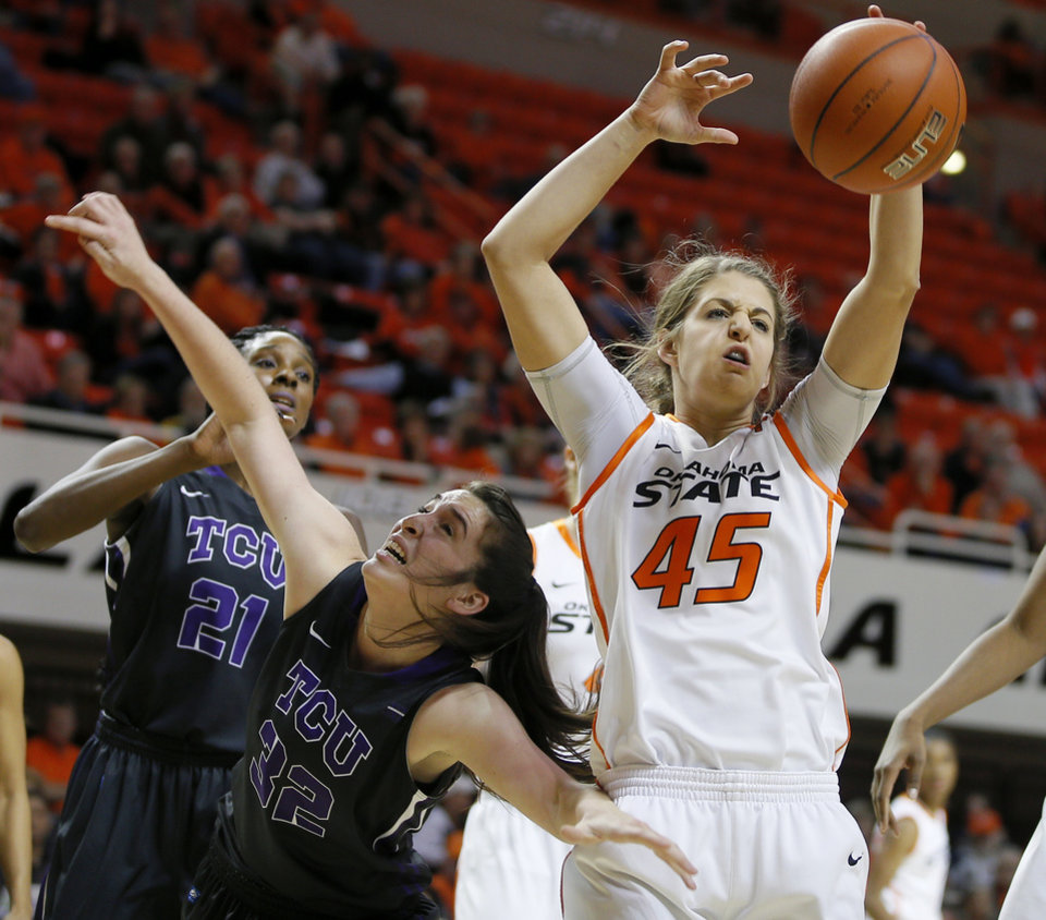 Oklahoma State\'s Katelyn Loecker (45) tries to gain control of the ball beside TCU\'s Caitlin Diaz (32) during a women\'s NCAA college basketball game between Oklahoma State University (OSU) and TCU at Gallagher-Iba Arena in Stillwater, Okla., Tuesday, Jan. 14, 2014. Photo by Bryan Terry, The Oklahoman