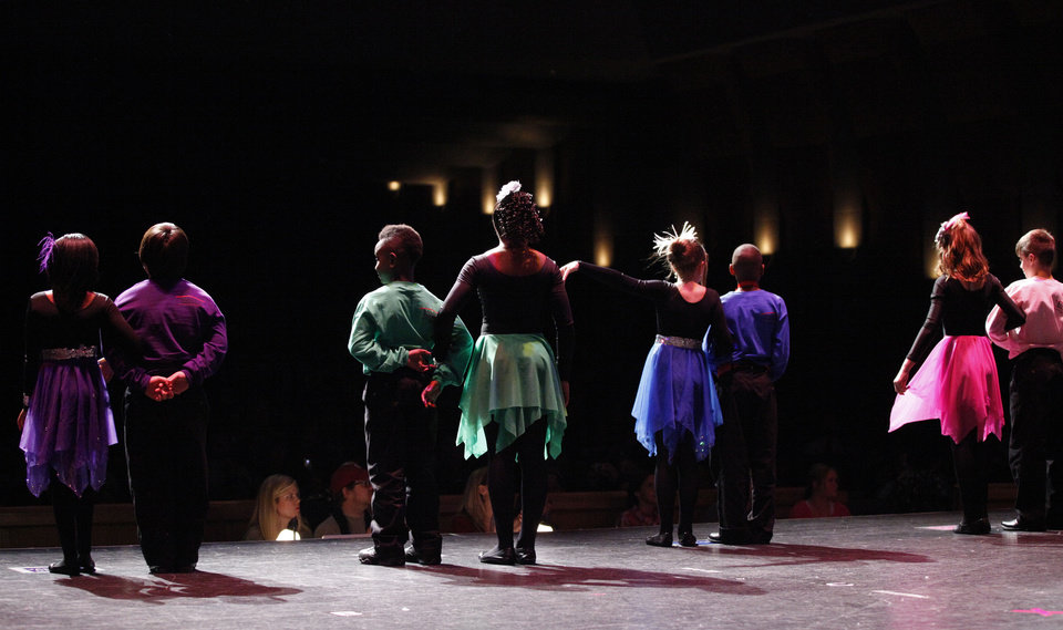 Dancers line up after finishing their routine at a dance competition at the Rose State Performing Arts Theatre in Midwest City. Photo by Bryan Terry, The Oklahoman <strong>BRYAN TERRY - THE OKLAHOMAN</strong>