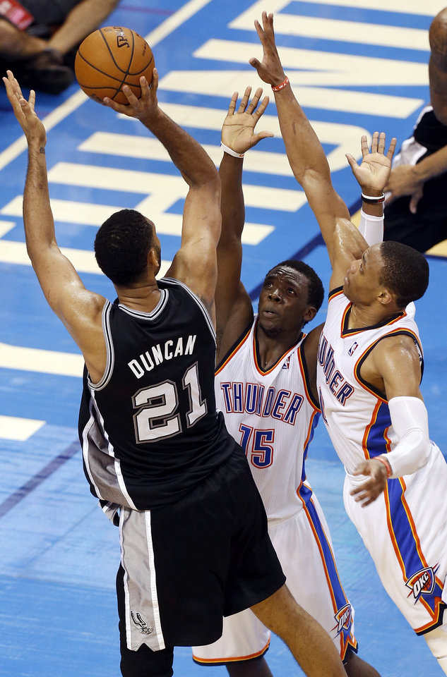 Photo - San Antonio's Tim Duncan (21) shoots against Oklahoma City's Reggie Jackson (15) and Russell Westbrook (0) in overtime during Game 6 of the Western Conference Finals in the NBA playoffs between the Oklahoma City Thunder and the San Antonio Spurs at Chesapeake Energy Arena in Oklahoma City, Saturday, May 31, 2014. The Spurs won 112-107 in overtime. Photo by Nate Billings, The Oklahoman