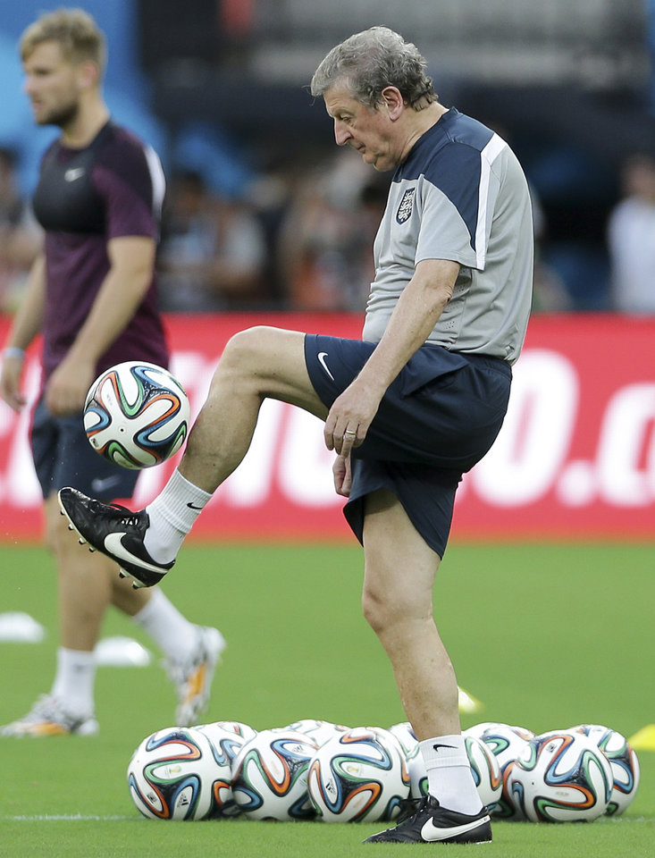 Photo - England manager Roy Hodgson juggles during a training session at Arena da Amazonia in Manaus, Brazil, Friday, June 13, 2014.  England plays in group D of the 2014 soccer World Cup. (AP Photo/Antonio Calanni)