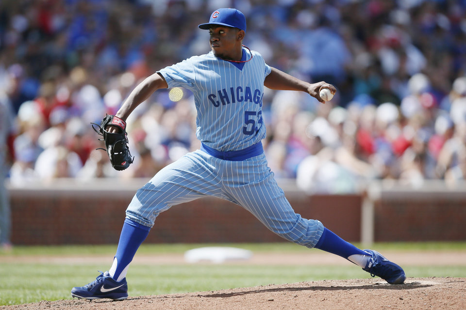 Photo - Chicago Cubs relief pitcher Wesley Wright delivers against the St. Louis Cardinals during the seventh inning of a baseball game on Sunday, July 27, 2014, in Chicago. (AP Photo/Andrew A. Nelles)