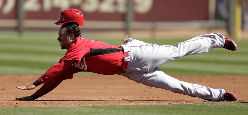 Cincinnati Reds' Emmanuel Burriss slides into second as he is caught stealing during the third inning of an exhibition spring training baseball game against the Kansas City Royals, Friday, March 1, 2013, in Surprise, Ariz. (AP Photo/Charlie Riedel)