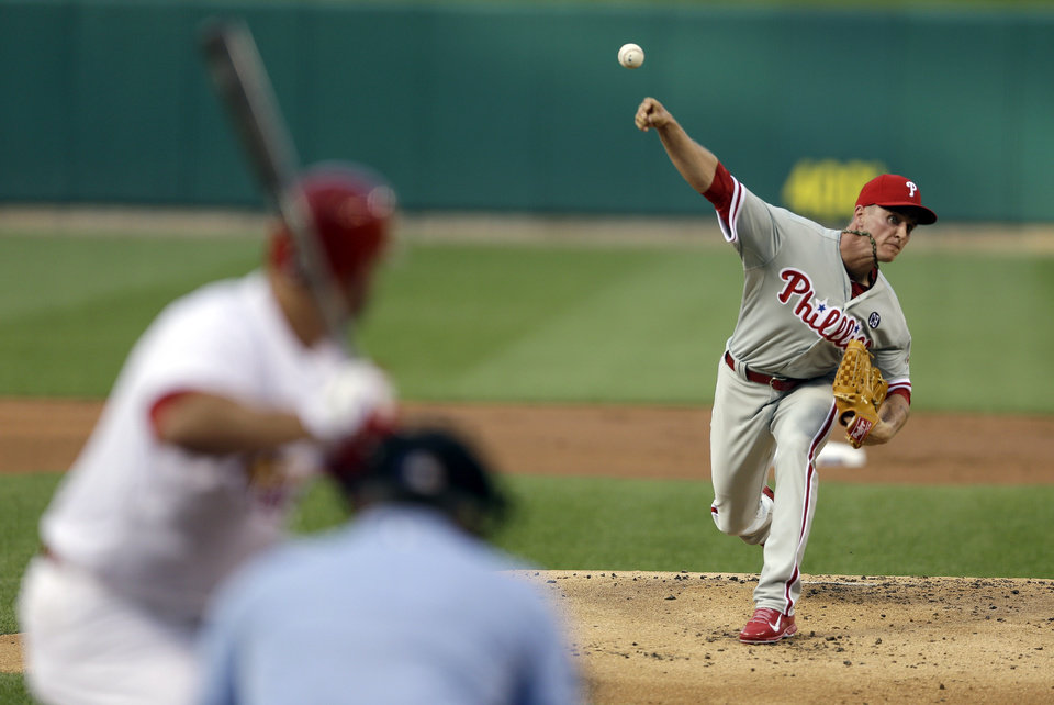 Photo - Philadelphia Phillies starting pitcher David Buchanan throws during the first inning of a baseball game against the St. Louis Cardinals, Thursday, June 19, 2014, in St. Louis. (AP Photo/Jeff Roberson)