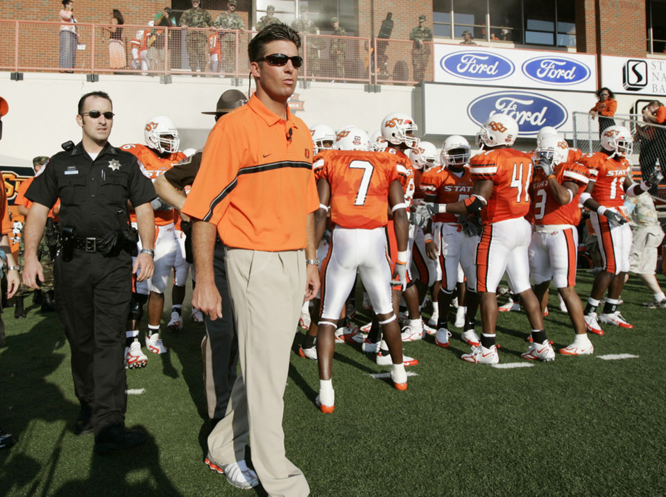 Photo - Oklahoma State University (OSU) vs Montana State University (MSU) college football at Boone Pickens Stadium in Stillwater, OK, September 3, 2005.  Head coach Mike Gundy gets ready to lead the team onto field for the first time as head coach. Oklahoman staff photo by Steve Gooch.