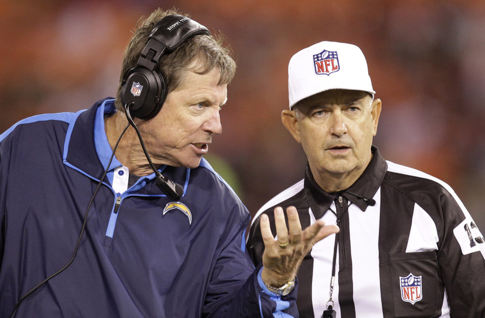 Photo -   San Diego Chargers head coach Norv Turner, left, argues with an official during the second half of an NFL preseason football game against the San Francisco 49ers in San Francisco, Thursday, Aug. 30, 2012. (AP Photo/Ben Margot)