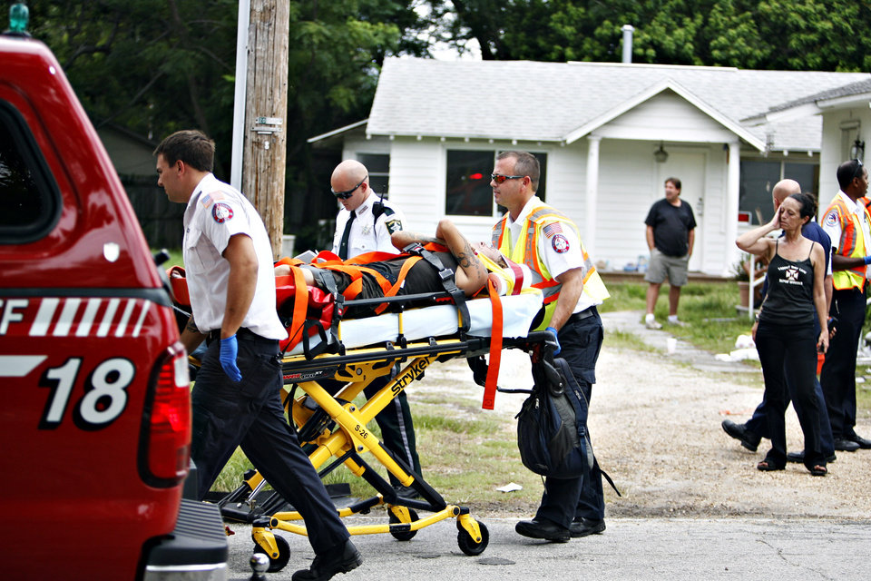 Photo -   A person reportedly injured by Anthony Giancola is wheeled to a waiting ambulance, in Lealman, Fla., Friday, June 22, 2012. Authorities said Giancola, an ex-Tampa Bay-area middle school principal who lost his job over a drug arrest five years ago, went on a rampage Friday, stabbing several people, killing at least two. Authorities said there were 11 victims in all, and several are being treated at area hospitals for injuries ranging from minor to life-threatening. (AP Photo/Tampa Bay Times, Melissa Lyttle) TAMPA OUT; CITRUS COUNTY OUT; PORT CHARLOTTE OUT; BROOKSVILLE HERNANDO TODAY OUT