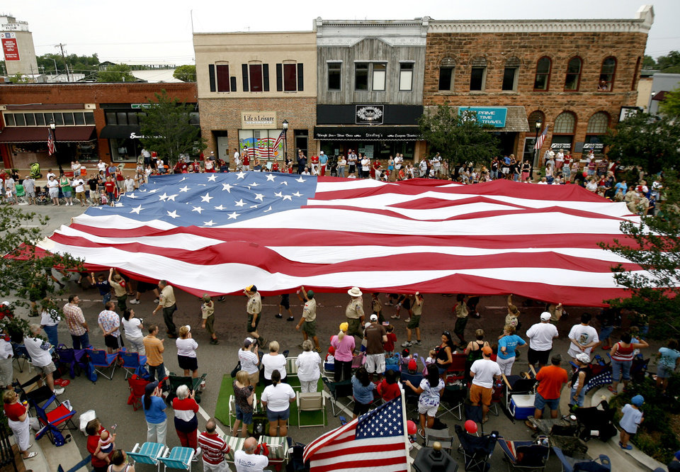 Boy Scout troops carry an American flag down Broadway in Edmond, Okla., during the LibertyFest Parade Saturday, July 4, 2009. Photo by Bryan Terry, The Oklahoman