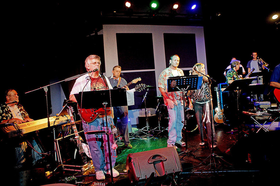 Photo - Phil Moss, second from left, performs with the Old Bulldog Band at the UCO Jazz Lab on Friday, August 10, 2013. The band, composed of former Edmond Memorial High School graduates from the 60's and 70's, started a few years ago when Greg Moss wanted to put a band together for his 40th high school reunion. Old Bulldog Band plays rock hits from the 60's and 70's which Moss and the other band members love playing.