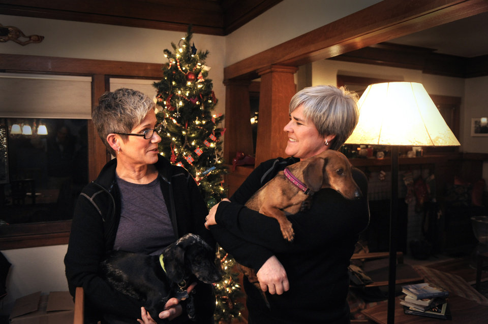 Former Army Major Margaret Witt, right, and Lori Johnson, left, stand in their south hill home, Monday, Dec. 3, 2012 in Spokane, Wash. They are planning to marry in a few weeks after receiving one of the first marriage licenses for same sex couples this week. Witt fought the Army over